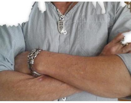 צמיד עור קלוע , משולב בשרשרת קלועה מכסף , לגבר ולאישה , צמיד עור וכסף עבודת יד,עיצוב מיוחד של שילוב כסף ועור , מעצב דני קרמר , עיצוב תכשיטים