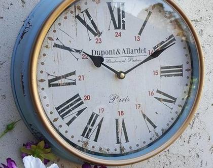 שעון קיר תכלת עם פס מוזהב
