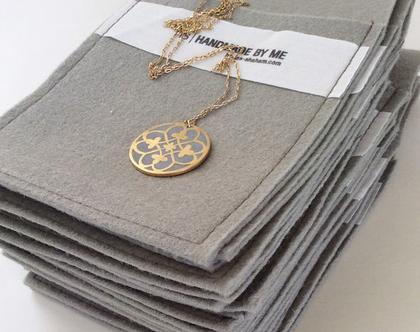 תליון מטבע פרלין זהב ובטון