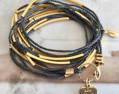 צמיד חוטים אפורים וצינורות זהב
