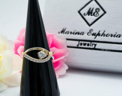 טבעת כסף בשילוב זהב משובצת זרקוניה.