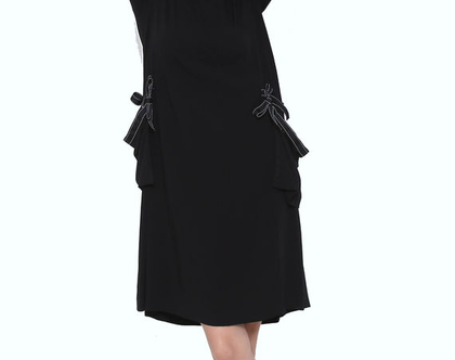 שמלת כיסים עם טריק שחור