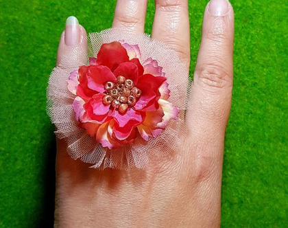 טבעת פרח ענק, אלה