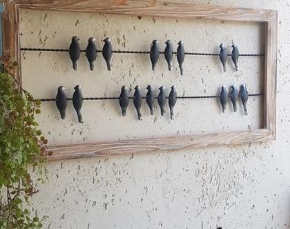 תמונת ציפורים שחורות שתי שורות
