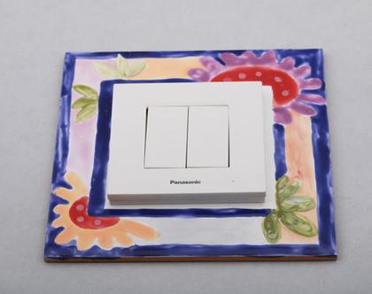 מסגרת למתגי חשמל מאריח מצויר בעבודת יד