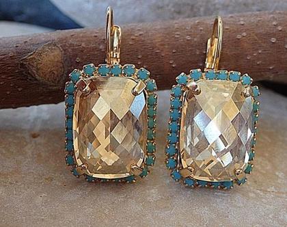 עגילים אבני סברובסקי,עגילי טורקיז ואבן זהב,עגילים תלויים.