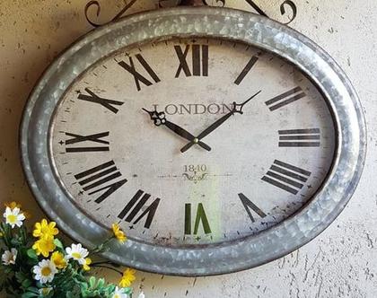 שעון קיר אובלי גדול עשוי פח