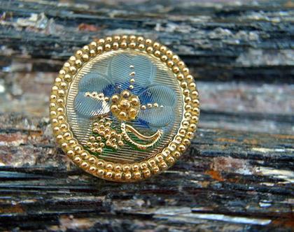 """כפתור זכוכית עם עיטור פרח בכחול וזהב כפתור אומנותי עבודת יד וצביעת יד בגודל 27 מ""""מ תוצרת צ'כיה"""