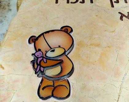 דובי מזכוכית בהדבקה על מצבה