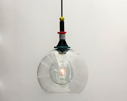 """נברשת מזכוכית שקופה קוטר 25 ס""""מ מקסימה כחלק מקבוצה של כדורים בגדלים וצבעים שונים"""