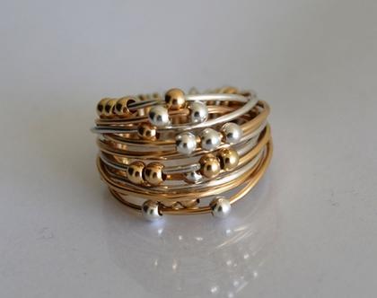 טבעת מלופפת בחוטי גולדפילד וכסף