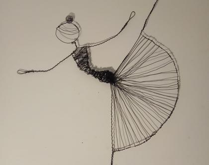 רקדנית מחוטי ברזל