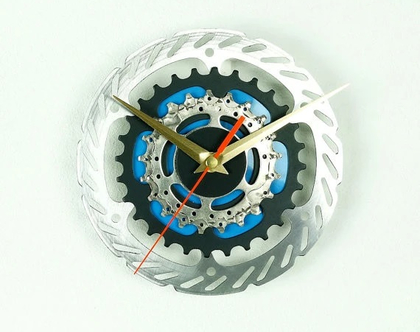 PL1 .שעון קיר מגלגל שיניים
