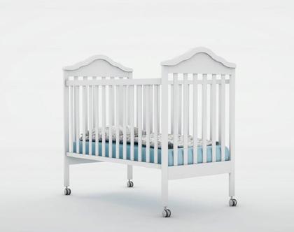 מיטת תינוק ענבר