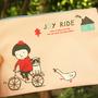 נרתיק בד מאוייר - ילדה על אופניים